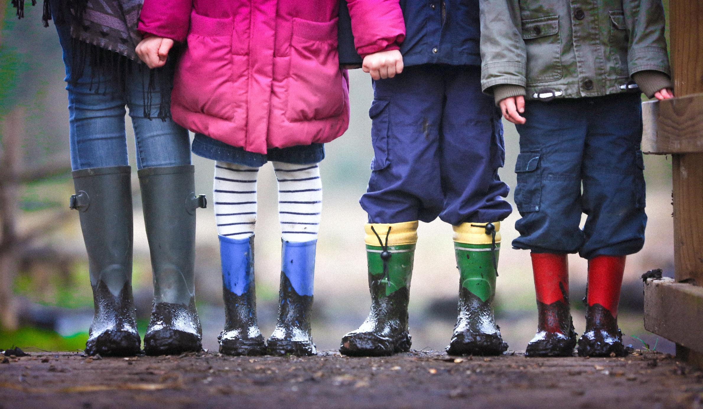 Four children in wellies stand in a row. Ben Wicks/Unsplash