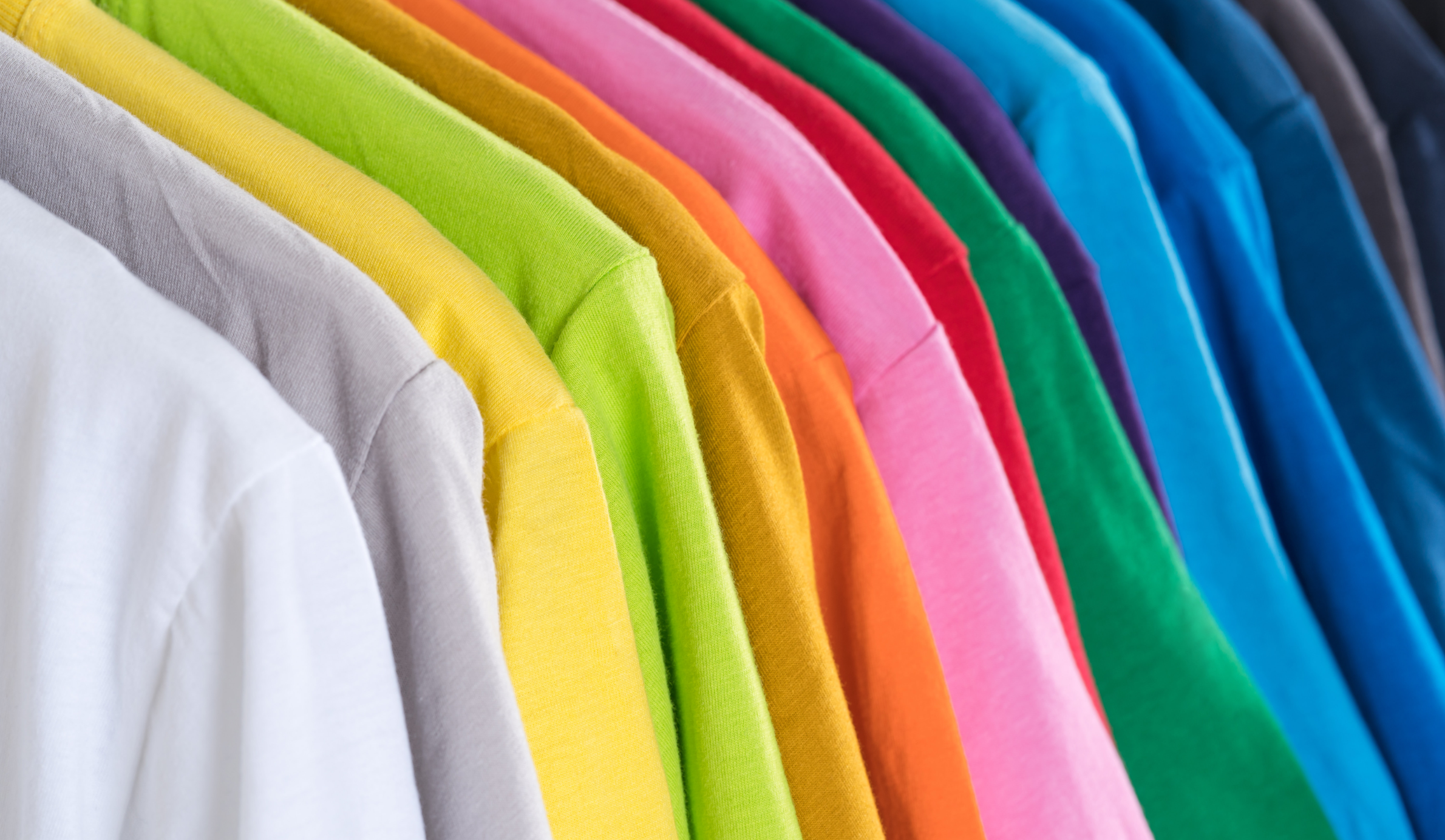A row to colourful t-shirts. Sorapong Chaipanya/Unsplash