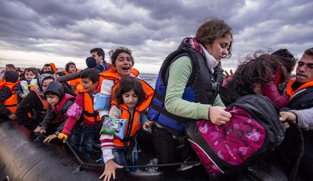 Syrian refugees arrive from Turkey to Greece 29 October 2015. (Nicolas Economou / Shutterstock.com)